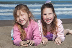 Girlfriends. Adorable little girls playing on the beach Stock Image