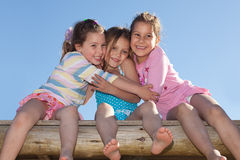 Girlfriends. Portrait of three little girls hugging and smiling Stock Images
