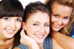 Girlfriends. Portrait of three smiling attractive girlfriends with beautiful eyes stock photo