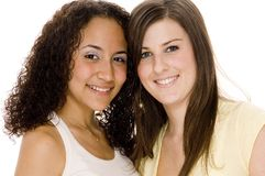 Girlfriends. Two young attractive women of different races Stock Image