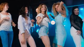 Girlfriends at bachelorette party funny dancing and sing. Slow motion.  stock video footage
