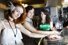 Girlfriends at bar with wineglasses Royalty Free Stock Image
