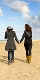 Girlfriends on beach Stock Image