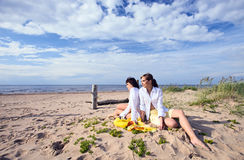 Girlfriends on a beach. Royalty Free Stock Photos