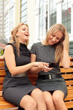 Girlfriends on a bench Stock Image