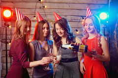 Girlfriends birthday party pour champagne into glasses Royalty Free Stock Photos