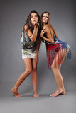 Girlfriends blowing kisses Royalty Free Stock Photo
