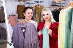 Girlfriends choosing warm jacket Royalty Free Stock Photo
