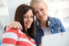 Girlfriends in college websurfing Royalty Free Stock Photo