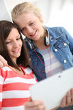 Girlfriends in college websurfing Stock Photography