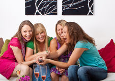 Girlfriends on the couch 2 Royalty Free Stock Image