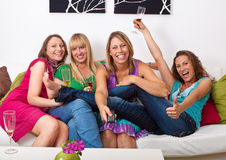 Girlfriends on the couch 4 Royalty Free Stock Images