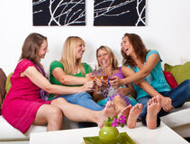 Girlfriends on the couch 5 royalty free stock photo