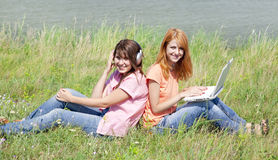 Girlfriends at countryside with laptop Royalty Free Stock Photography
