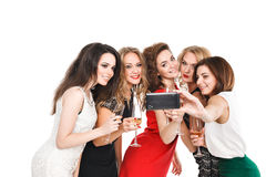Girlfriends do smartphone selfi isolated on white Royalty Free Stock Photo