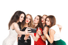 Girlfriends do smartphone selfi isolated on white Stock Image