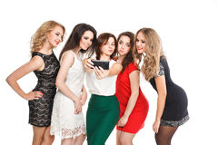 Girlfriends do smartphone selfi isolated on white Stock Photography