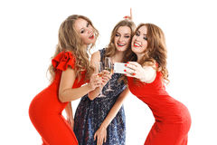 Girlfriends do smartphone selfi isolated on white stock photos