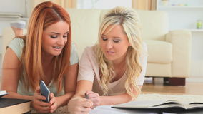 Girlfriends doing their homework together stock video