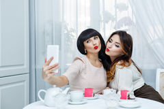 Girlfriends drink tea. Tea party. Selfie Stock Photo