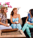 Girlfriends drinking coffee Stock Images