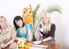 Girlfriends drinking coffee and having fun Stock Photo