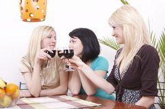 Girlfriends drinking wine and having fun Royalty Free Stock Photos