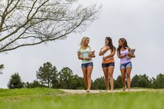 3 Girlfriends Enjoying A Day At The Park Before Heading To Class stock images