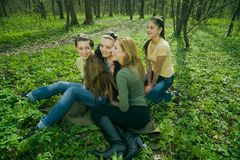 Girlfriends in the forest. Girlfriends talking and having fun in the forest stock images