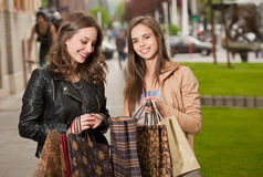 Girlfriends go shopping. Stock Photos