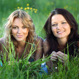 Girlfriends on grass Royalty Free Stock Photo