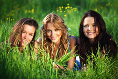 Girlfriends on grass Royalty Free Stock Photos