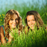 Girlfriends on grass Royalty Free Stock Photography