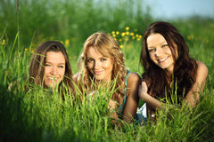 Girlfriends on grass Royalty Free Stock Image