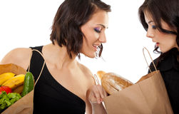 Girlfriends with groceries Stock Image