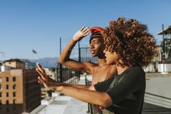 Girlfriends hanging out at a LA rooftop royalty free stock images