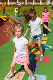 The girlfriends have fun playing hopscotch outdoors in the summer royalty free stock photo