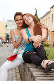 Girlfriends have fun in street Stock Photo