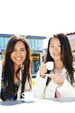 Girlfriends having coffee Royalty Free Stock Images