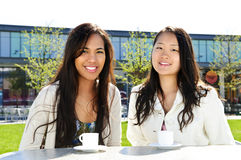 Girlfriends having coffee Stock Photos