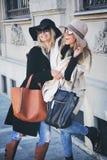 Girlfriends having fun on the street. Girlfriends huging and having fun on the street Royalty Free Stock Photo