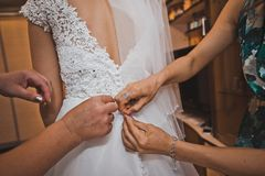 Girlfriends help to dress a dress to the bride 2027. Stock Images