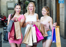 Girlfriends holding shopping paper bags Royalty Free Stock Image