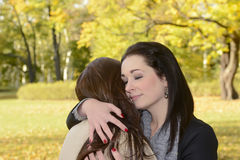 Girlfriends hugging Royalty Free Stock Photography