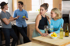 Girlfriends interested in men at a party flirting and talking secretly rumors Stock Images