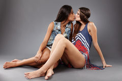 Girlfriends kissing on the lips Royalty Free Stock Photography