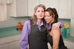 Girlfriends in a kitchen Royalty Free Stock Image