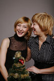 Girlfriends laugh in new year Royalty Free Stock Images
