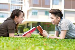 Studying on campus lawn Stock Photography