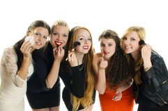 Girlfriends Make Up. Five pretty teenage girl standing together and apply make-up with lots of fun. Isolated against white background stock images
